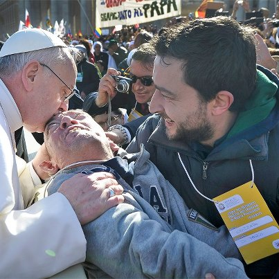 Pope kisses disabled