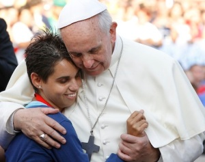 Pope embraces young woman during encounter with youth in Cagliari, Sardinia