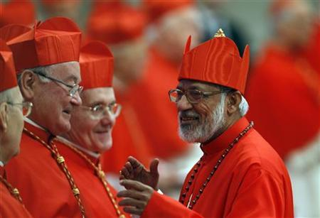 New Cardinal Alencherry of India talks with Cardinal Dolan of the U.S. during a consistory ceremony in Saint Peter's Basilica at the Vatican