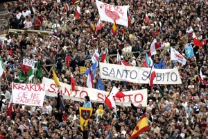 Crowds calling for Pope John Paul's immediate canonisation during his funeral in 2005.