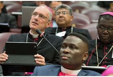 (speaking) Archbishop John Dew of New Zealand
