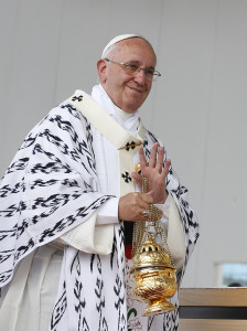 Pope Francis waves as he recognizes someone while using incense during Mass in Bicentennial Park in Quito, Ecuador, July 7. (CNS photo/Paul Haring) See POPE-UNITY July 7, 2015.