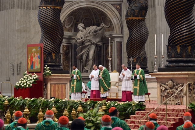"Pope Francis (C) leads a mass for the opening of the synod on the family on October 4, 2015 at St Peter's basilica in Vatican. Pope Francis opened a gathering of bishops intended to review Catholic teaching on the family against a backdrop of controversy over homosexuality. The church's second synod on the family opened in a tense atmosphere the day after a senior priest announced he was gay and accused the Vatican of ""institutionalised homophobia"". AFP PHOTO / TIZIANA FABI"