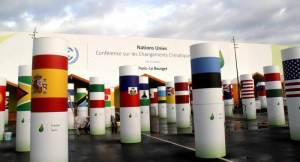 Pillars with national flags are seen at the entrance of Le Bourget, the Paris meeting-place of COP21