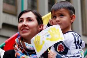 A mother and son celebrate the signing of the peace treaty on 23 June