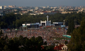 Pilgrims attend the Way of the Cross at Blonia Park during World Youth Day in Krakow, Poland July 29. (CNS photo/David W. Cerny, Reuters)