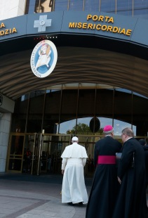 Pope Francis walks through the Holy Door as he visits the Divine Mercy Shrine in Lagiewniki, a suburb of Krakow, Poland, July 30. (CNS photo/Paul Haring) See POPE-POLAND-MERCY-SHRINE July 30, 2016.