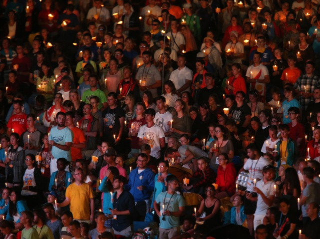 World Youth Day pilgrims hold candles during a July 30 prayer vigil with Pope Francis at the Field of Mercy in Krakow, Poland. (CNS photo/Bob Roller)