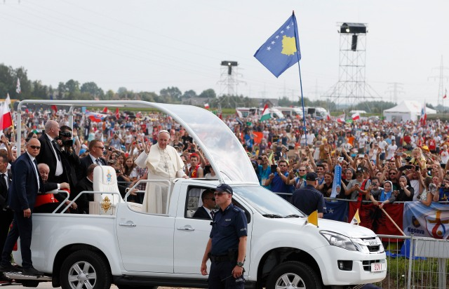 Pope Francis arrives to celebrate the closing Mass of World Youth Day at Campus Misericordiae in Krakow (CNS photo/Paul Haring)