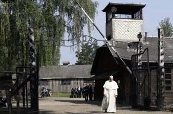 Pope Francis walks through the main gate of Auschwitz in Oswiecim this morning. (AP Photo/Gregorio Borgia)