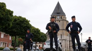 Security guards outside the church in Rouen where Fr Hamel was slain