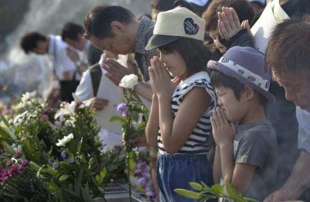 People pray at a memorial in Hiroshima, Japan, Aug. 6, to commemorate the victims of the atomic bombing of the city by the United States in 1945. (CNS photo/Paul Jeffrey)