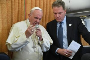 Pope Francis on the flight from Azerbaijan, flanked by Greg Burke, director of the Holy See Press Office.