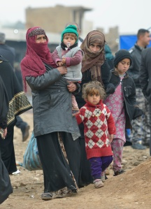 An Iraqi family leaves a processing center for displaced people outside Mosul, Iraq, Jan. 27. (CNS photo/Paul Jeffrey)